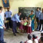 Pattarai Perumbudur - Glovis staff present materials to the children.